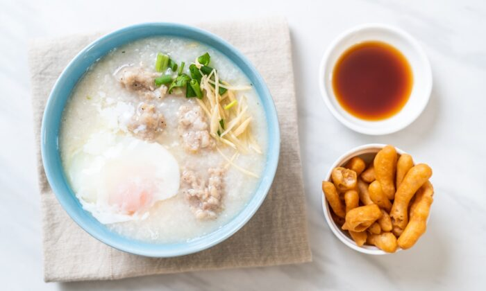 All the variations of congee simmer down to the same basic idea: Cook a little rice in a lot of water, until you have a thick, warm cloud. Simply add flavor, and serve. (gowithstock/Shutterstock)