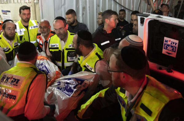 Israeli rescue workers carry a body