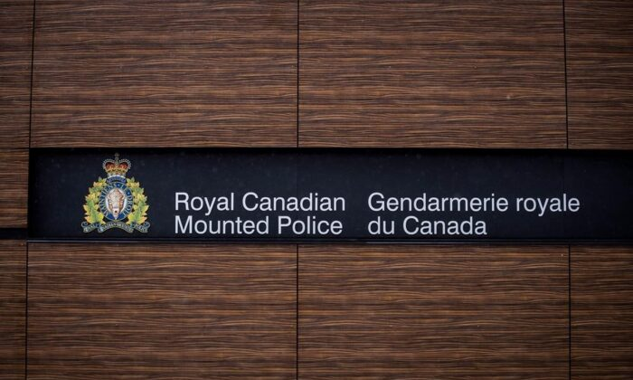 """The RCMP logo is seen outside Royal Canadian Mounted Police """"E"""" Division Headquarters, in Surrey, B.C., on April 13, 2018. A review by the national spy watchdog has found inconsistencies when it comes to federal efforts to ensure information sharing with foreign agencies does not result in torture. (Darryl Dyck / The Canadian Press)"""