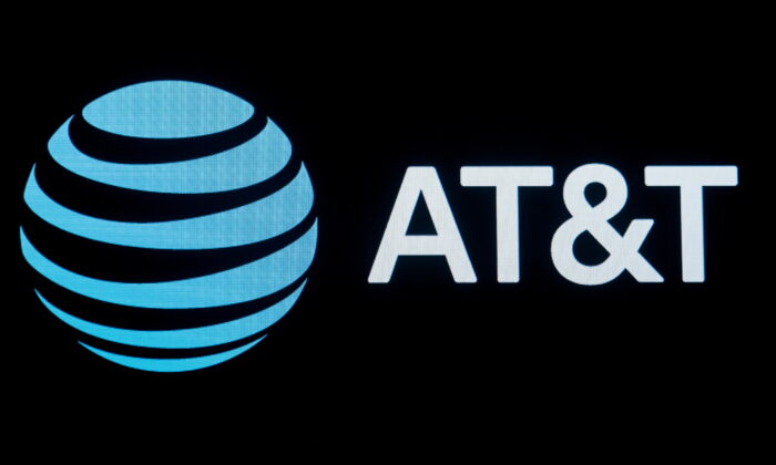 The company logo for AT&T is displayed on a screen on the floor at the New York Stock Exchange (NYSE) in New York, on Sept. 18, 2019. (Brendan McDermid/Reuters)