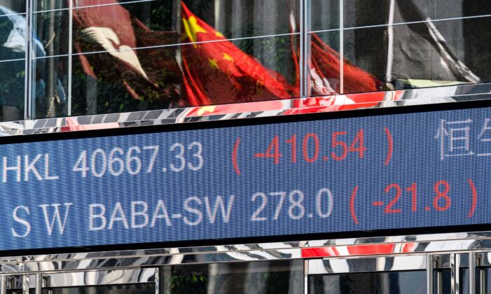 Stock price of Alibaba Group Holding Ltd (BABA-SW) (top C) drops in Hong Kong Stock Exchange on Nov. 4, 2020, after its financial wing Ant Group's record-breaking IPO suspended the night before. (Anthony Wallace/AFP via Getty Images)