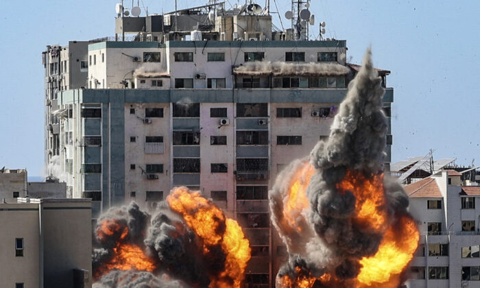 A ball of fire erupts from the Jala Tower as it is destroyed in an Israeli airstrike in Gaza City, controlled by the Palestinian Hamas terrorists, on May 15, 2020. (Mahmud Hams/AFP via Getty Images)