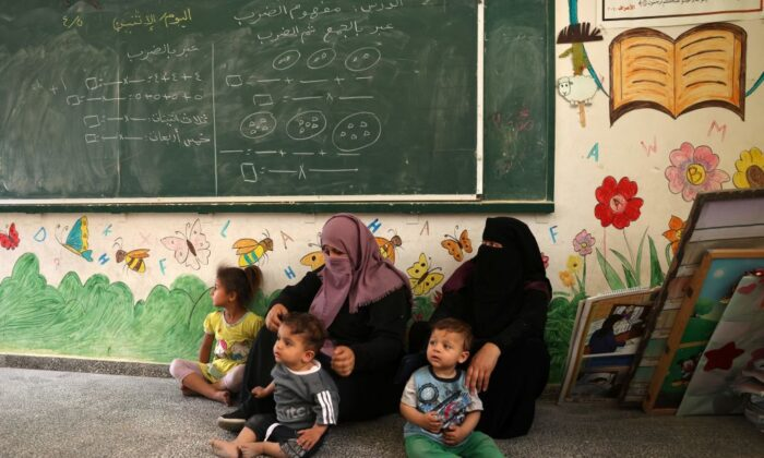 Palestinian women and children take shelter at a United Nations school in Rafah in the southern Gaza Strip on May 17, 2021. (Said Khatib/AFP via Getty Images)