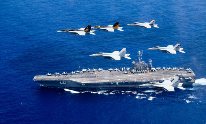 In this handout provided by the U.S. Navy, a combined formation of aircraft from pass in formation above the Nimitz-class aircraft carrier USS John C. Stennis. (Lt. Steve Smith/U.S. Navy via Getty Images)