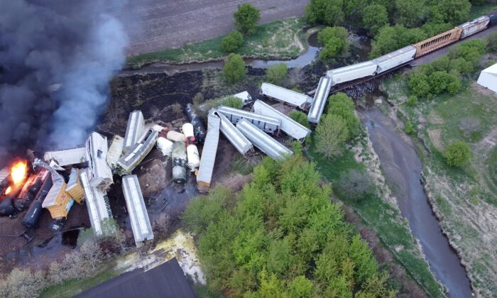 Fire is seen on a Union Pacific train carrying hazardous material that has derailed in Sibley, Iowa, in this still frame obtained from social media drone video dated May 16, 2021. (Nathan Minten via Reuters)
