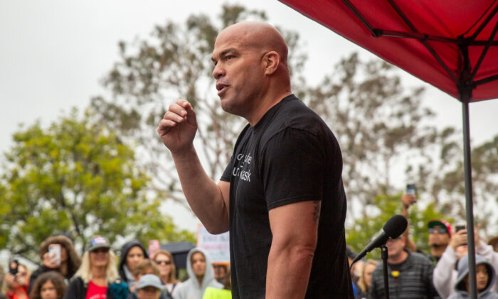 Former Huntington Beach Mayor Pro Tem Tito Ortiz speaks to parents and students as they gather in protest of wearing masks in schools outside The Orange County Board of Education in Costa Mesa, Calif., on May 17, 2021. (John Fredricks/The Epoch Times)