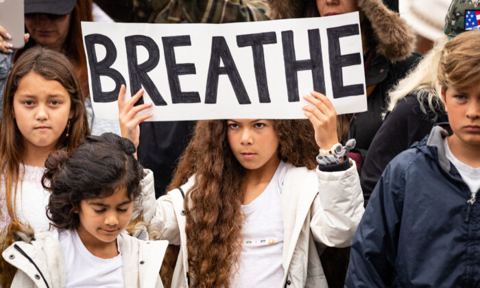 Parents and students gather to protest wearing masks in front of the Orange County Department of Education in Costa Mesa, Calif., on May 17, 2021. (John Fredricks/The Epoch Times)