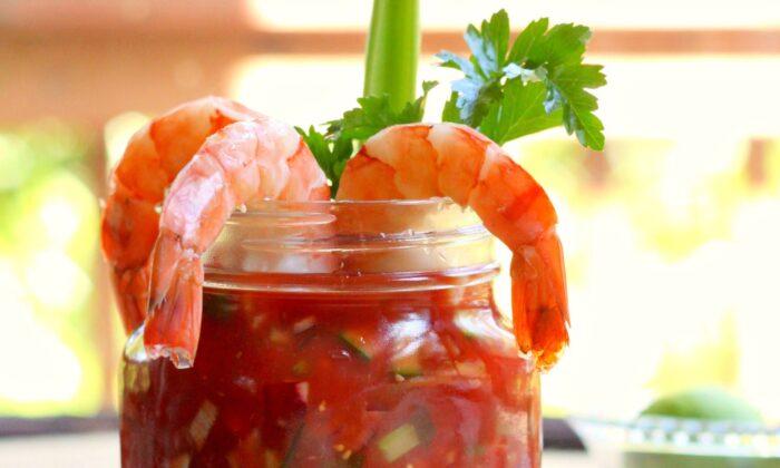 Drape freshly poached and chilled shrimp over a shrimp cocktail-inspired gazpacho for a light spring or summer meal. (Lynda Balslev for Tastefood)