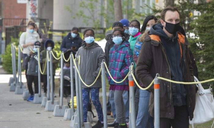 People line up at a COVID-19 testing clinic in Montreal on May 11, 2021. (The Canadian Press/Ryan Remiorz)