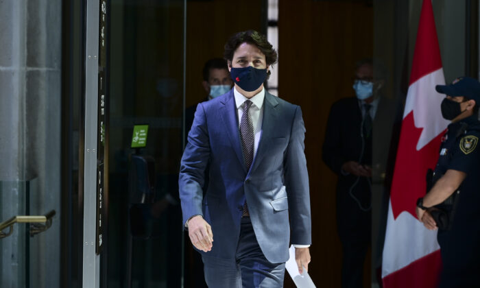 Prime Minister Justin Trudeau makes his way to hold a press conference in Ottawa, Canada, on May 18, 2021. (Sean Kilpatrick/The Canadian Press)