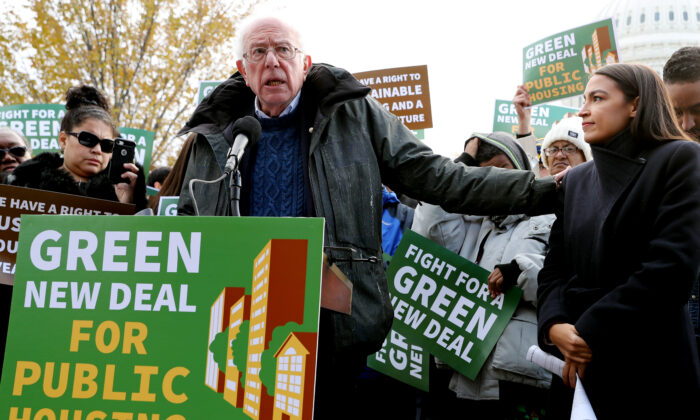 Then-Democratic presidential candidate Sen. Bernie Sanders (I-Vt.) (L) and Rep. Alexandria Ocasio-Cortez (D-N.Y.) hold a news conference to introduce legislation to transform public housing as part of their Green New Deal proposal outside the U.S. Capitol in Washington on Nov. 14, 2019, DC. (Chip Somodevilla/Getty Images)