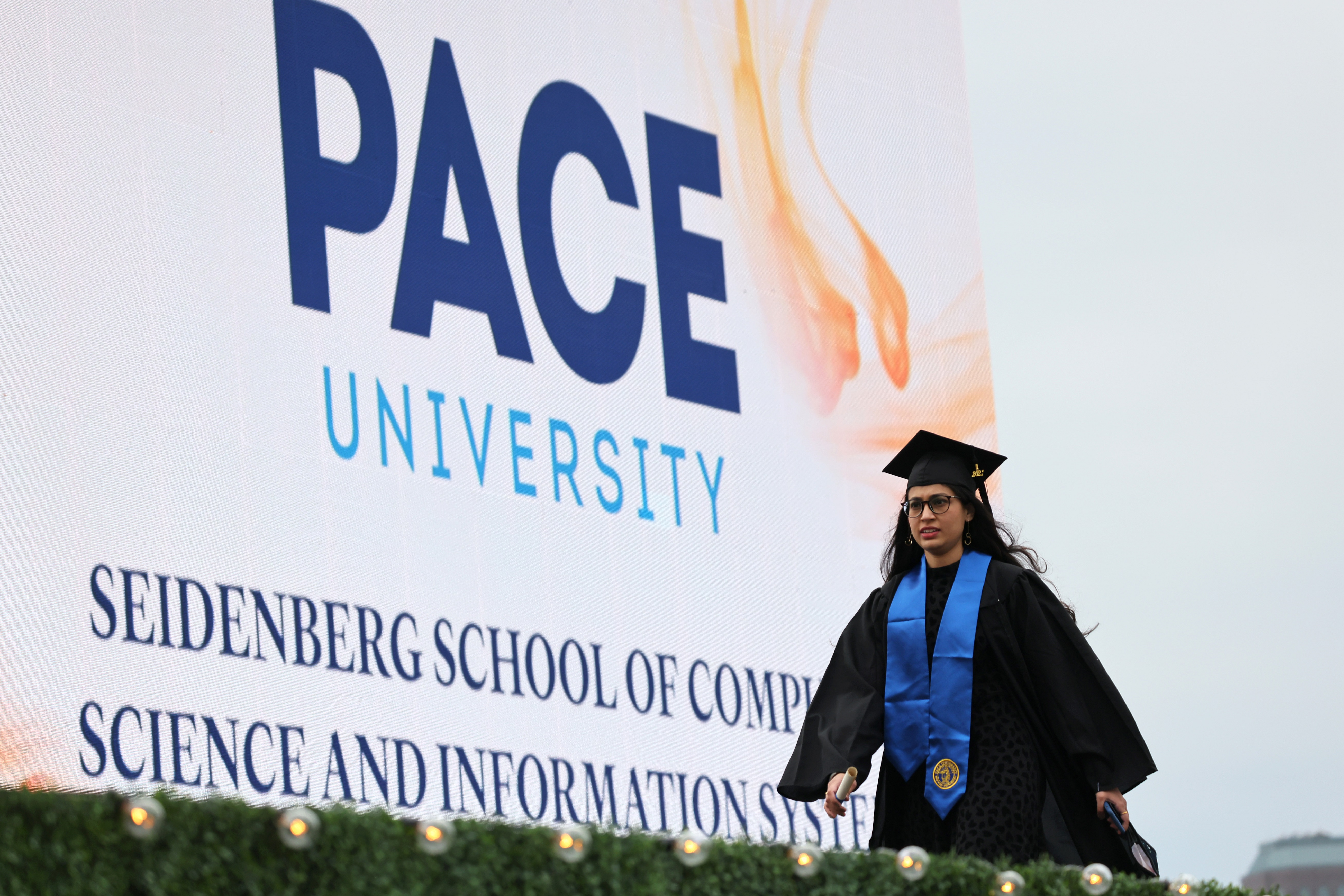 New York City's Pace University Holds Small In Person Graduation Ceremony At South Street Seaport
