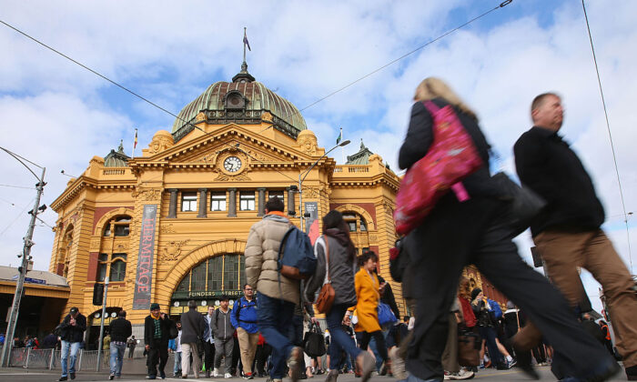 Commuters leave and arrive at Flinders Street Station on Sept. 4, 2015 in Melbourne, Australia. (Michael Dodge/Getty Images)