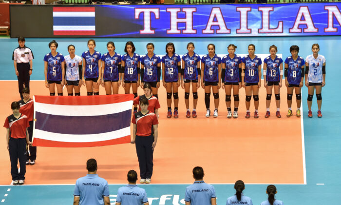 Players of Thailand line up for the national anthem prior to the Women's World Olympic Qualification game between Thailand and Dominican Republic at Tokyo Metropolitan Gymnasium in Tokyo, Japan on May 14, 2016.  (Koki Nagahama/Getty Images)