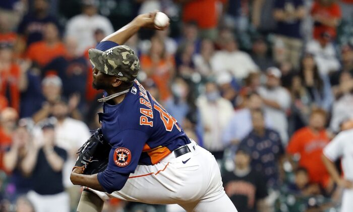 Enoli Paredes #48 of the Houston Astros pitches in the ninth inning against the Texas Rangers at Minute Maid Park in Houston, Texas, on May 16, 2021. (Bob Levey/Getty Images)