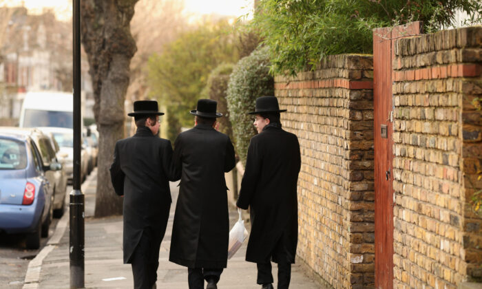 Jewish men walk along the street in the Stamford Hill area of north London on Jan. 19, 2011. (Oli Scarff/Getty Images)