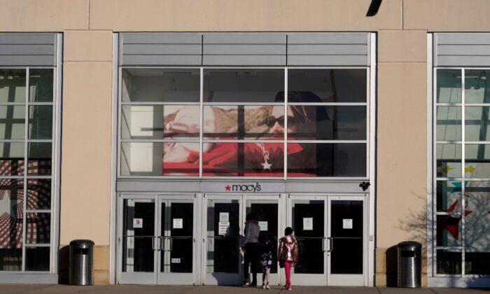 Shoppers arrive at a Macy's in Charlotte, N.C., on Feb. 22, 2021. (Chris Carlson/AP Photo)