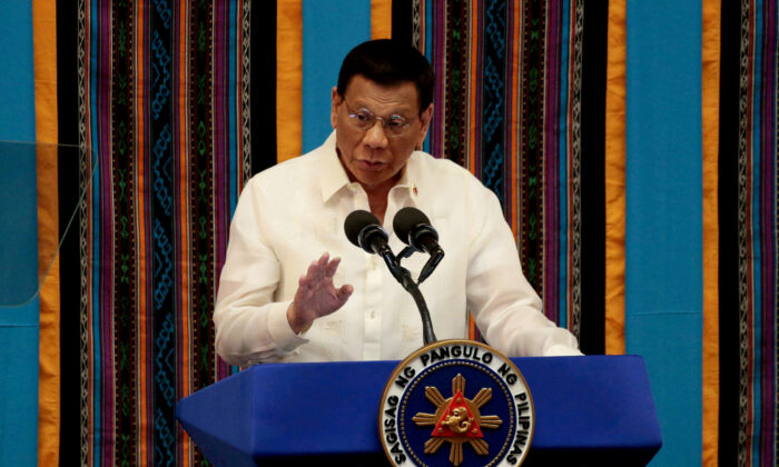 Philippine President Rodrigo Duterte gestures during his fourth State of the Nation address at the Philippine Congress in Quezon City, Metro Manila, Philippines, on July 22, 2019. (Eloisa Lopez/Reuters)