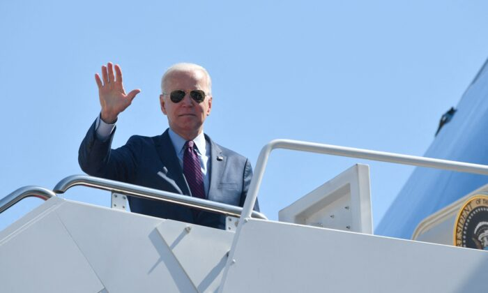 President Joe Biden makes his way to board Air Force One before departing from Andrews Air Force Base, Md., on May 18, 2021. (Nicholas Kamm/AFP via Getty Images)