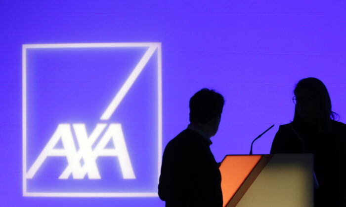 People stand in front of the logo of AXA Group prior to the company's 2018 annual results presentation, in Paris, France, on Feb. 21, 2019. (Thibault Camus/AP Photo)