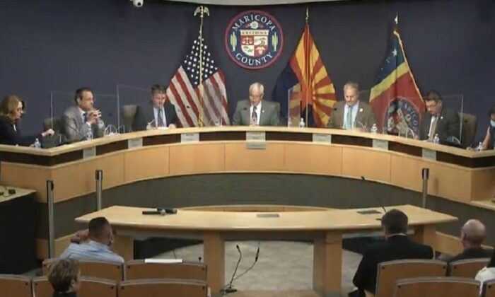 In this image from video captured from the Maricopa County Board of Supervisors website, Chairman Jack Sellers, center, and members hold a meeting regarding requests by the Arizona Senate in Maricopa County, Ariz., on May 18, 2021. (Screenshot via The Epoch Times)
