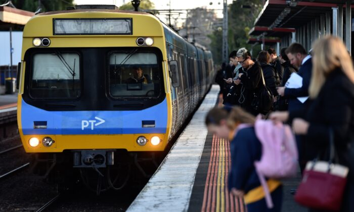 Peak hour commuters wait for a city loop train at Newmarket Station ahead of a train strike in Melbourne, Friday, Sept. 4, 2015. (AAP Image/Tracey Nearmy)