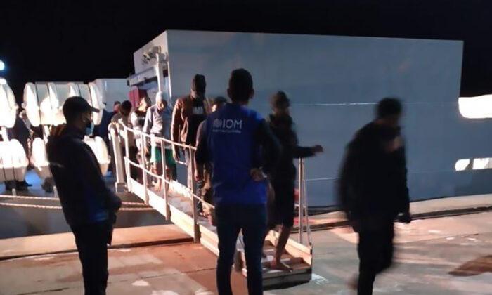 Migrants disembarking in Tunisia, late Monday, on May 17, 2021. (IOM Tunisia via AP)