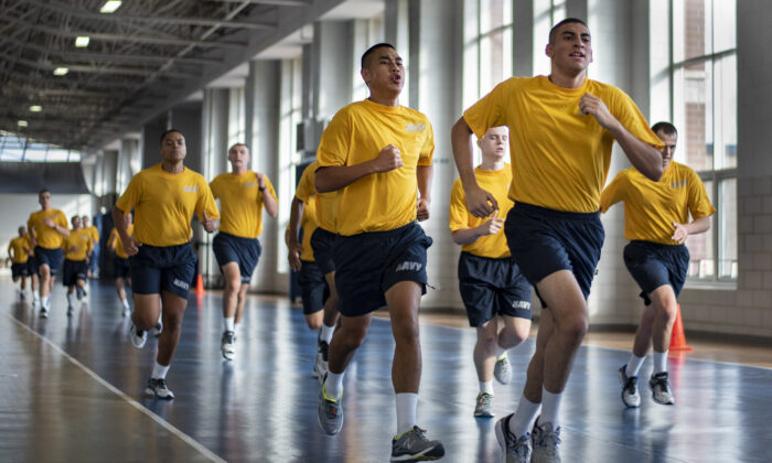 For some who join the armed forces, military boot camp serves as a transition to manhood. Above, recruits run sprints during a U.S. Navy boot camp session in Great Lakes, Ill. (Spencer Fling/U.S. Navy)