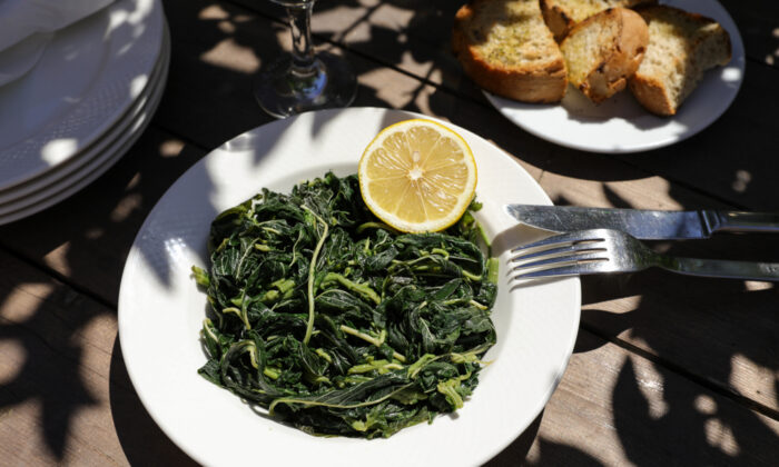 The most typical preparation of horta is also the simplest: boiled until tender, seasoned with salt, and served with generous drizzles of olive oil and lemon juice. (Victoria Kurylo/Shutterstock)