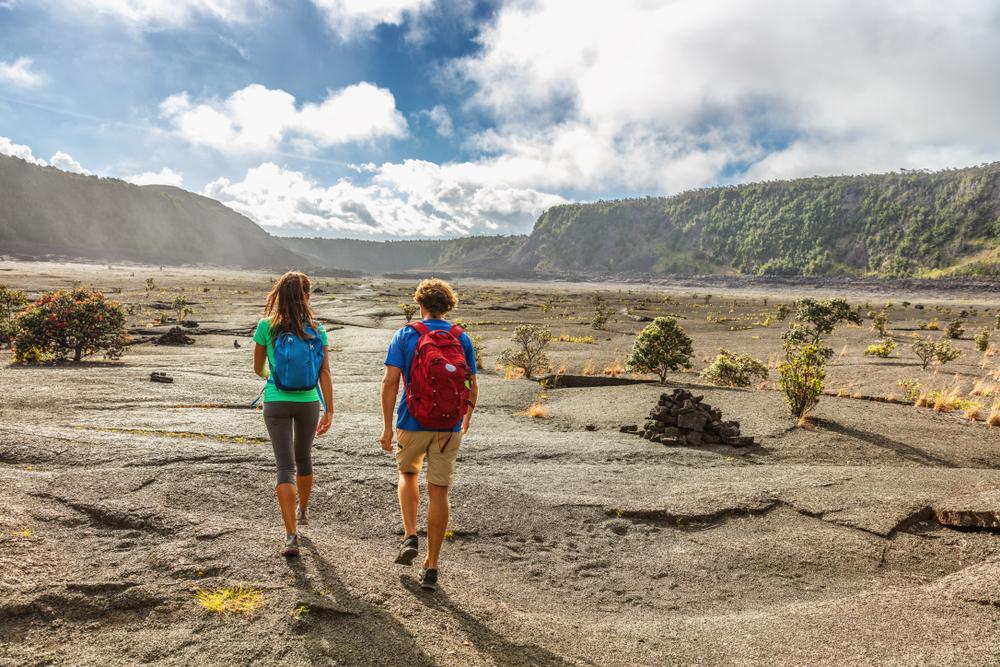 Couple,Tourists,Hikers,Walking,On,Kilauea,Iki,Crater,Trail,Hike