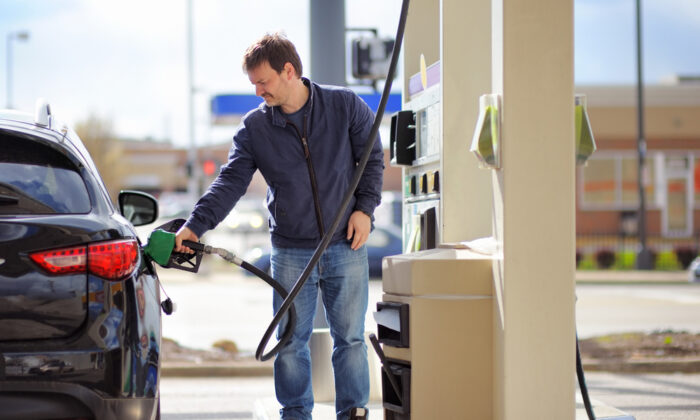 While the price of gasoline remains out of our control, we can control how often we visit the filling station. So, how low can you go? (Maria Sbytova/Shutterstock)
