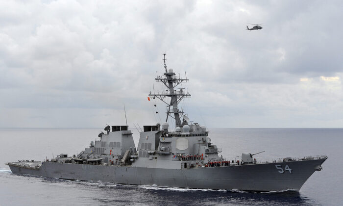 The U.S. Navy guided-missile destroyer USS Curtis Wilbur patrols in the Philippine Sea on Aug. 15, 2013. (U.S. Navy/Mass Communication Specialist 3rd Class Declan Barnes/Handout via Reuters)