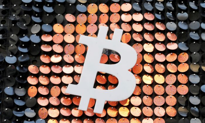 The logo of the Bitcoin digital currency is seen in a shop in Marseille, France, on Feb. 7, 2021. (Eric Gaillard/Reuters)