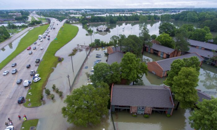An aerial view of the flooded Siegen Calais apartments in Baton Rouge, La., on May 18, 2021. (John Ballance/The Advocate via AP)
