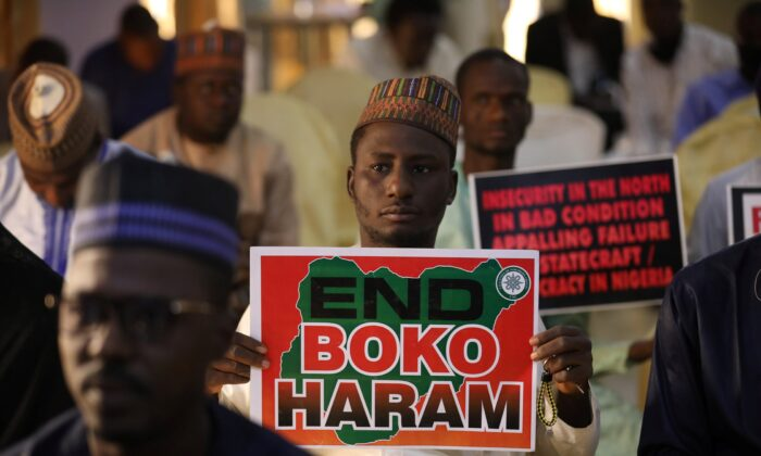 """Supporters of the """"Coalition of Northern Groups"""" (CNG) rally to urge authorities to rescue hundreds of abducted schoolboys, in northwestern state of Katsina, Nigeria on Dec. 17, 2020. (Kola Sulaimon/ AFP) (Photo by KOLA SULAIMON/AFP via Getty Images)"""