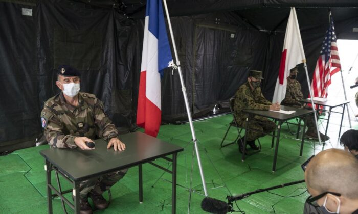 French Army lieutnant colonel Henri Marcaillou (L), Japan Self-Defense Force colonel Masashi Hiraki (C), and U.S. Marines lieutnant colonel Jeremy Nielson (R) attend a joint military drill between the Japan Self-Defense Force, the French Army, and U.S. Marines at the Kirishima exercise area in Ebino, Miyazaki Prefecture, on May 15, 2021. (Charly Triballeau/ AFP via Getty Images)