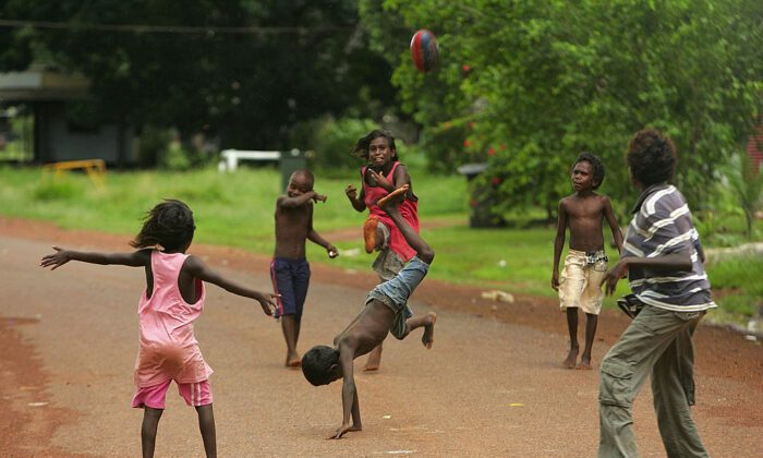 Children play football on the street on Tiwi Island on the December 23, 2007. (Ezra Shaw/Getty Images)