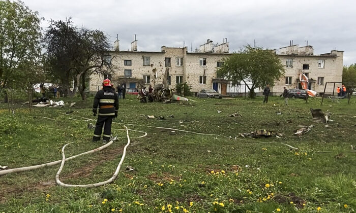 A firefighter stands at the scene of crashes Belarusian military Russian-built Yak-130 trainer jet in Baranovichi, Belarus, on May 19, 2021. (Vadim Yakubenko, BetTA photo via AP)