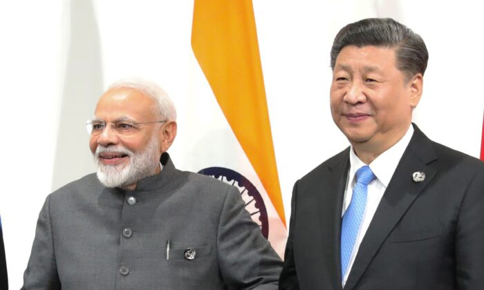 Indian Prime Minister Narendra Modi and Chinese President Xi Jinping hold a meeting on the sidelines of the G20 summit in Osaka, on June 28, 2019. (Mikhail Klimentyev/SPUTNIK/AFP via Getty Images)