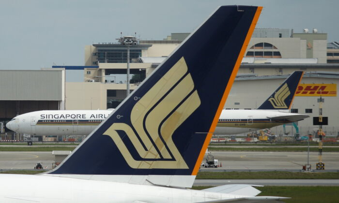 Singapore Airlines planes sit on the tarmac at Changi Airport in Singapore, on Dec. 8, 2020. (Edgar Su/Reuters)