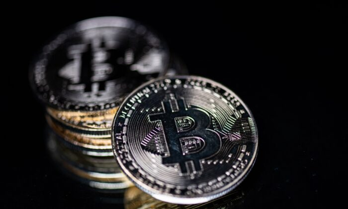 A physical imitation of the Bitcoin crypto currency is seen in Paris,  France, on April 26, 2021. (Martin Bureau/AFP via Getty Images)