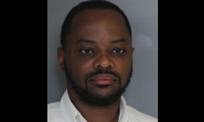 State Senator Darius J. Brown as seen in a mug shot (Delaware State Police)