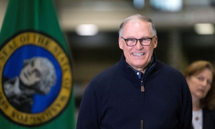 Washington State Gov. Jay Inslee and other leaders speak to the press in Seattle, Wash., on March 28, 2020. (Karen Ducey/Getty Images)