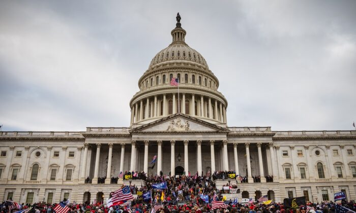 A large group of protesters stand on the east steps of the Capitol Building in Washington on Jan. 6, 2021. (Jon Cherry/Getty Images)