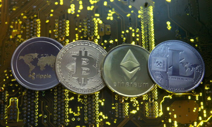 Representations of the Ripple, bitcoin, etherum, and Litecoin virtual currencies are seen on a PC motherboard in this illustration picture, on Feb. 14, 2018. (Dado Ruvic/Reuters)