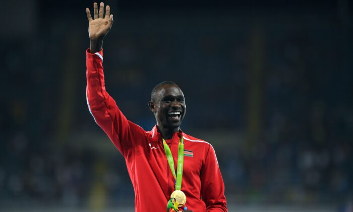 Gold medallist Kenya's David Lekuta Rudisha celebrates on the podium for the Men's 800 meter during the athletics at the Rio 2016 Olympic Games at the Olympic Stadium in Rio de Janeiro, on Aug. 16, 2016.  (Johannes Eisele/AFP via Getty Images)