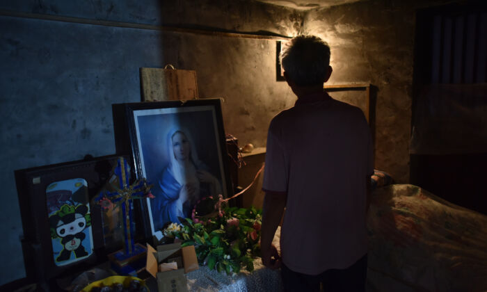 A man stands in a room in a house church in Puyang, Henan Province, China, on Aug. 13, 2018. (Greg Baker/AFP via Getty Images)