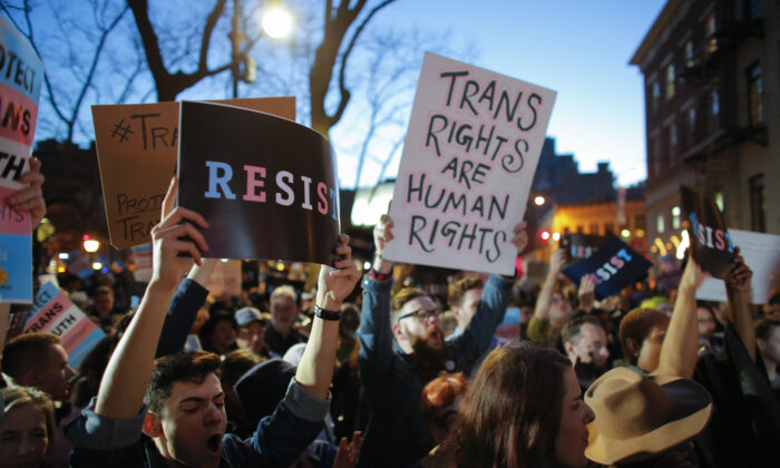 People take part in a rally to support transgender causes in the Greenwich Village area of New York on Feb. 23, 2017. (Kena Betancur/AFP via Getty Images)