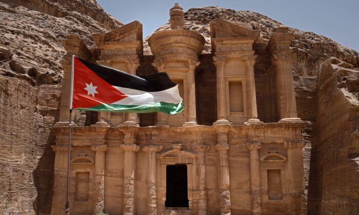 A picture taken on May 24, 2019, shows the Jordanian flag fluttering in front of the Nabataean Monastery (Ad Deir) in Jordan's ancient city of Petra. (Photo credit should read THOMAS COEX/AFP via Getty Images)