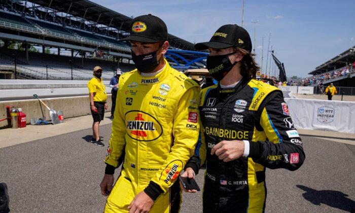 Scott McLaughlin, left, of New Zealand, and Colton Herta walk out of the pit area during practice for the Indianapolis 500 auto race at Indianapolis Motor Speedway in Indianapolis on Thursday, May 20, 2021. (Michael Conroy/AP Photo/)